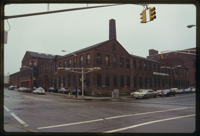 Exterior view of Watson Machine International viewed from the corner of Grand Street and Railroad Avenue.