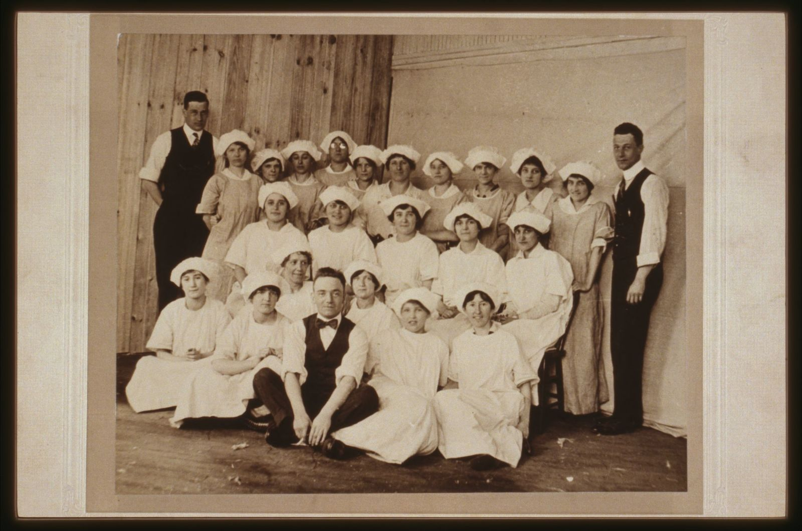 Formal portrait of workers and managers at Newberger's Towel Factory, Paterson, ca. 1918.