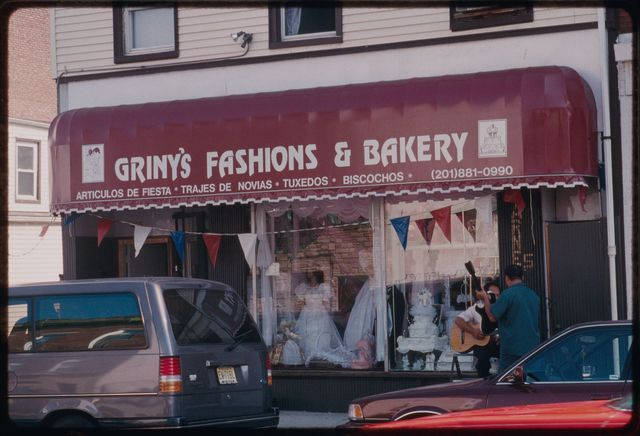 Griny's Fashions & Bakery is located on Main Street, a block south of Grand Street.