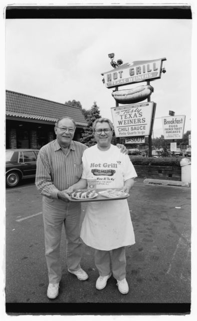 Hot Grill co-owner Nick Doris (right) stands with friend Bill Betts (another hot Texas Wiener restaurateur) in front of The Hot Grill.