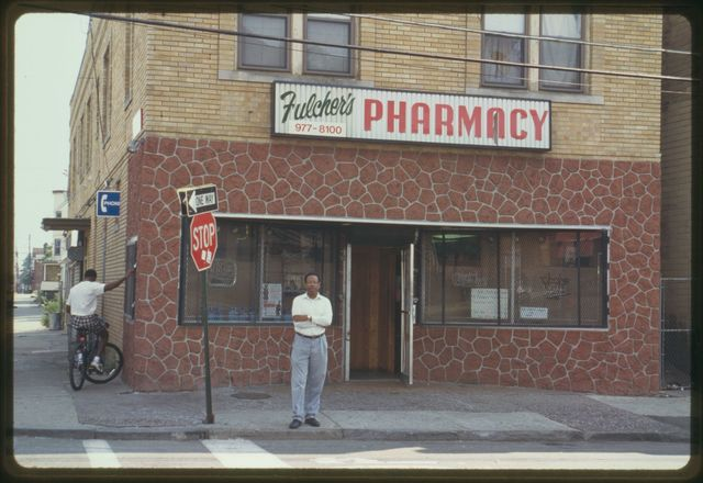 Howard Fulcher stands in front of the pharmacy.