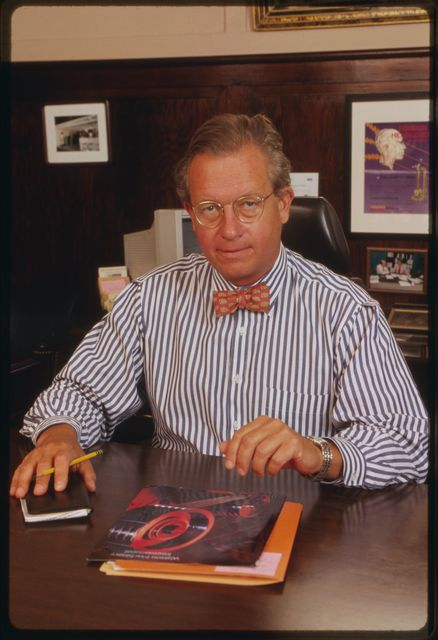 Ian M. Watson McLaughlin, president of Watson Machine International, in his office;  company brochure is on top of the desk.