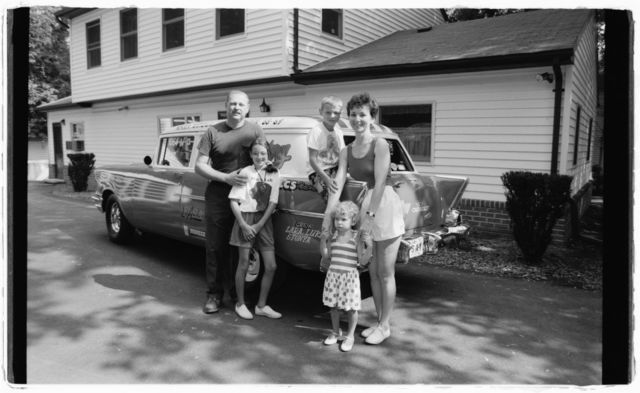 Larry Schneider, his wife Bonnie, and their children Tanya and Luke stand in front of Larry's '56 Chevy dragster that he has customized in his own machine shop.