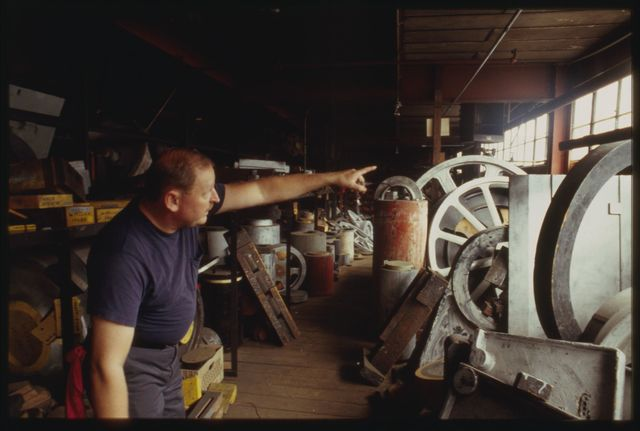 Lead man Larry Schneider showing old patterns upstairs  at Watson, these were used by Watson to cast machine parts when the foundry was operating.