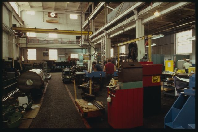 Looking south in machine shop toward assembly area and paint booth at Watson.