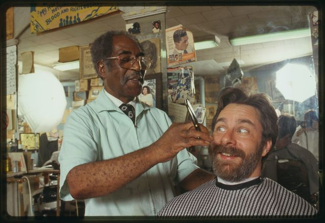 Louis McDowell pretends to give fieldworker David Taylor a shave and a haircut.