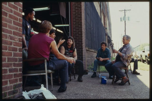 Machine shop workers on afternoon break at Dale Street side of shop.