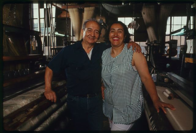 Maria Atiles poses with technician (loom fixer) George Lopez.