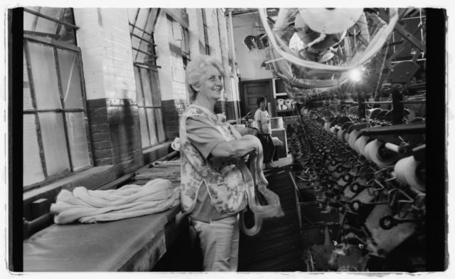 """Mary Tomlin at work on """"tube winding"""" on first floor."""