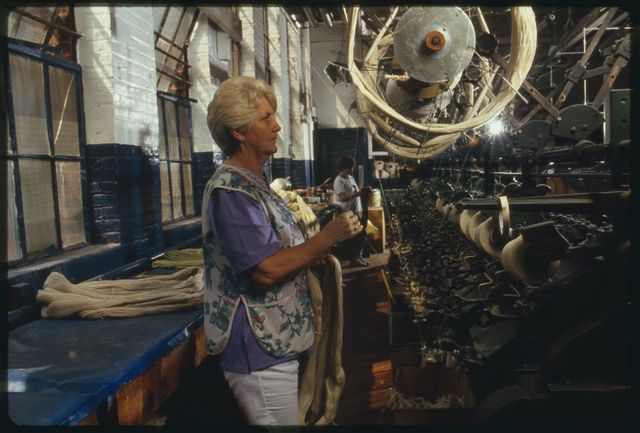 "Mary Tomlin working on ""tube winding"" on first floor."