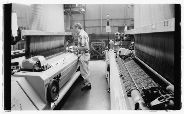 Mechanic John Clark checks loom; it's an electronic jacquard loom that's directed by a computerized Staubli JC-4 controller.