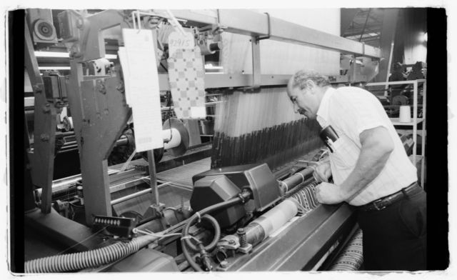 Mechanic trainee Herman Cortese works on a loom.