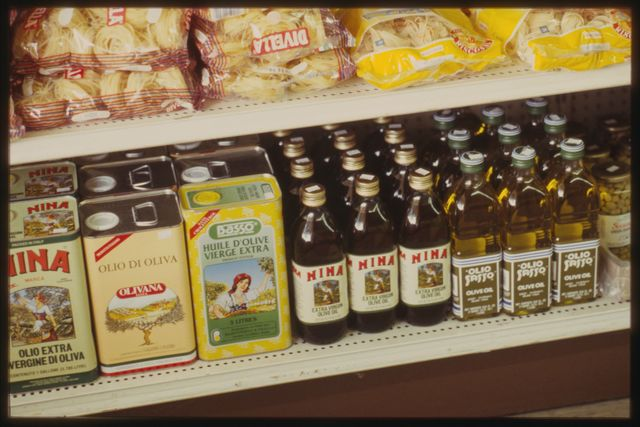 Olive oil and pasta products for sale in the shop.  Rocco caters to a predominantly Italian American, or Italian-speaking, clientele.
