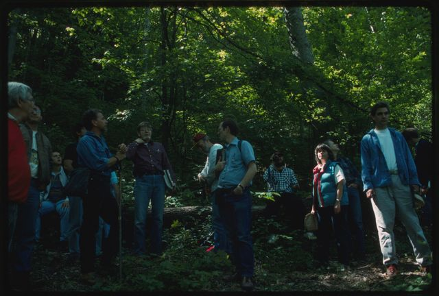 Orie Loucks orienting Appalachia Forest Action Project volunteers to mixed mesophytic habitat on the property of Joe Aliff, Rock Creek