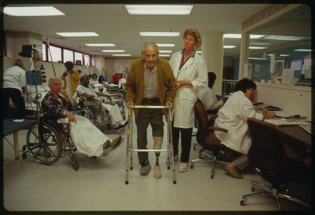 Patient Frank DeGraw of Bloomingdale, N.J., and physical therapist Lisa Minnema in the physical therapy unit, 1st floor.