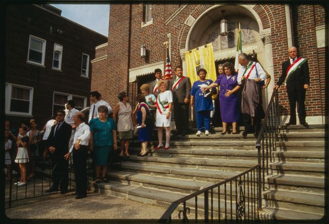 People stand on front steps of church before the start of Mass; Paterson mayor William Pascrell is standing second from the right.