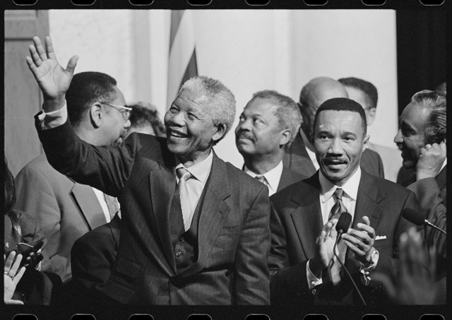 [President of South Africa, Nelson Mandela with members of the Congressional Black Caucus including Representative Kweisi Mfume, at an event at the Library of Congress]