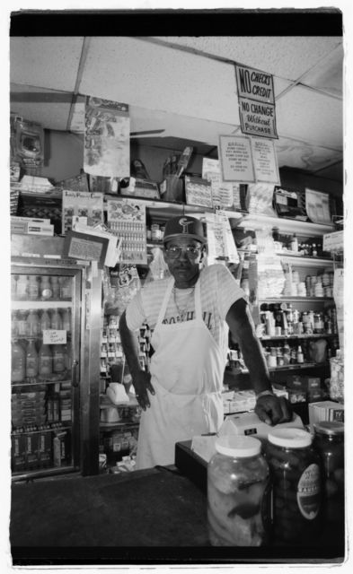 Proprietor Doug Owens poses beside the store's counter.