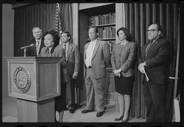 [Representative Patsy Mink announces the formation of the Congressional Asian Pacific American Caucus at a press conference with (left to right) Representatives Don Edwards and Norman Mineta, Guam Delegate Robert Underwood, and Representatives Nancy Pelosi and Neil Abercrombie]