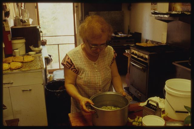 Rocco's mother puts finishing touches on the pasta fagioli.