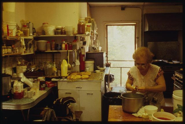 Rocco's mother puts finishing touches on the pasta fagioli; here she is about to lift the pot and carry it to the stove.