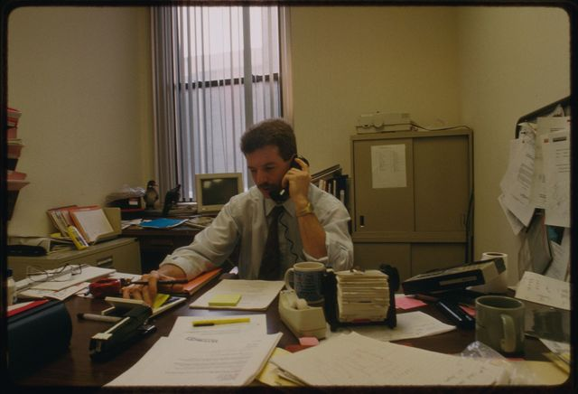 Salesman Pete Buonforte in his office upstairs at Watson.