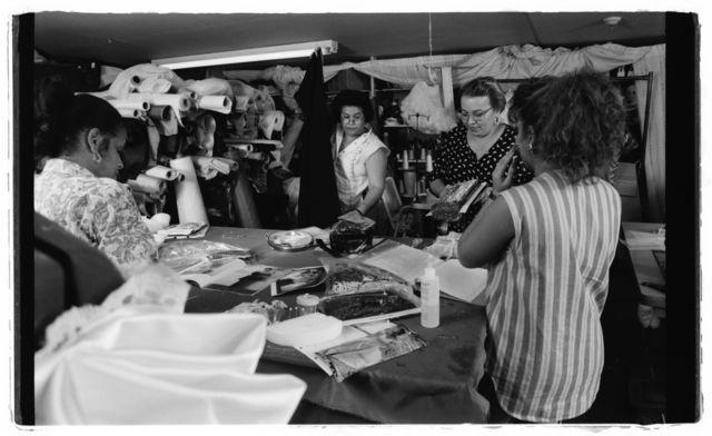 "Seamstresses Aurora Goicoechea and Milagros ""Mille"" Cueto, proprietor Elsa Mantilla, and customer Brenda Freytes."