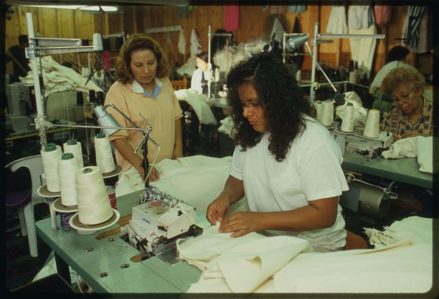 Sewing-machine operators assembling garments.