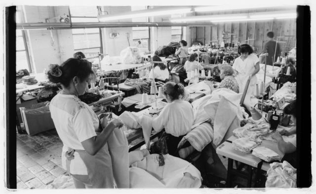 Sewing machine operators making garments.