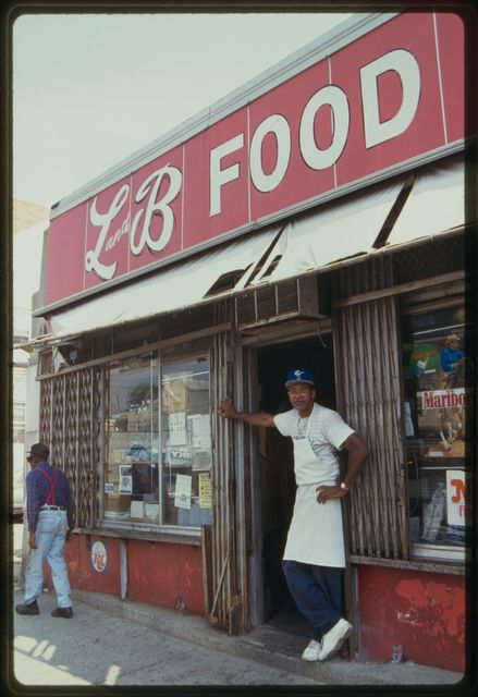 Shop owner Doug Owens stands in front of L & B Food Center.
