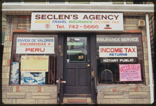 Sign for Seclen's [Travel] Agency, 245 21st Avenue.