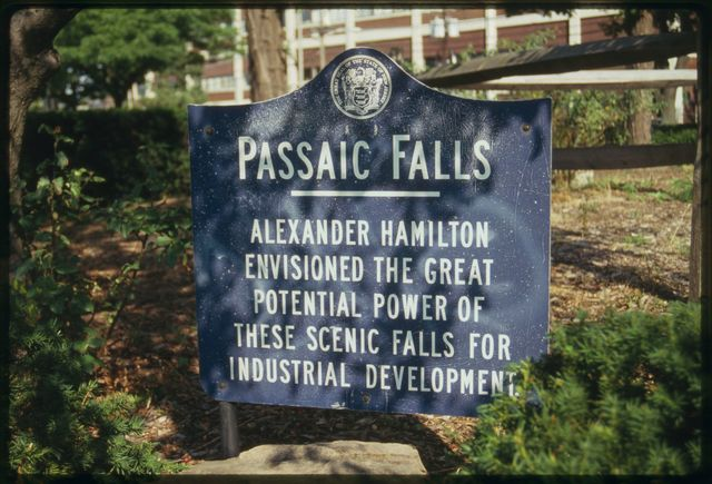 Sign near Great Falls on the Passaic, it reads:  Passaic Falls.  Alexander Hamilton envisioned the great potential power of these scenic falls for industrial development.