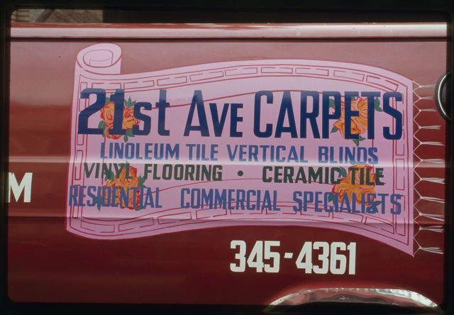 Sign on side of van advertising 21st Avenue Carpets business.