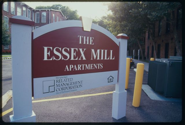 Sign outside Essex Mill Apartments; the building is at 24 Mill Street.