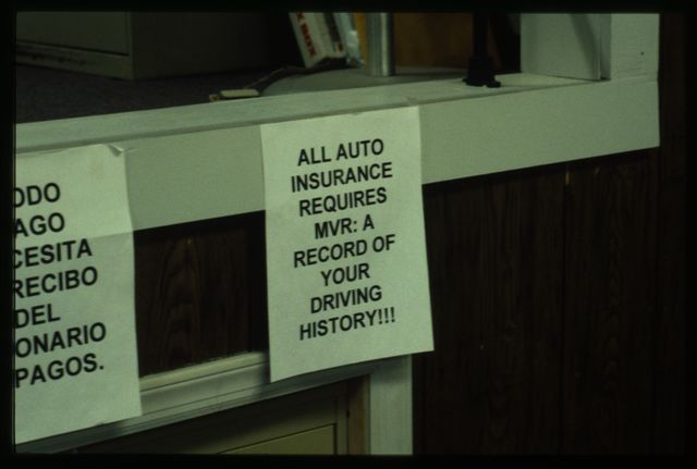 Signage in the shop, with instructions for customers in Spanish, Italian, and English (the three languages spoken in the office).