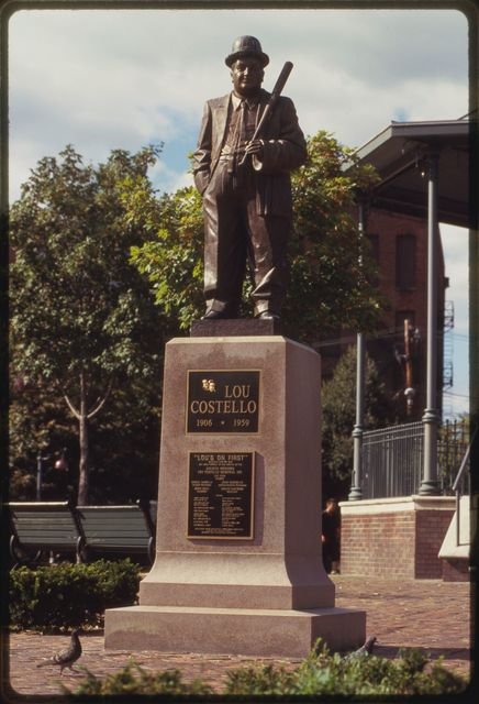 "Statue of Paterson native Lou Costello with banner that reads:  ""Lou Costello Memorial,"" Cianci Street."