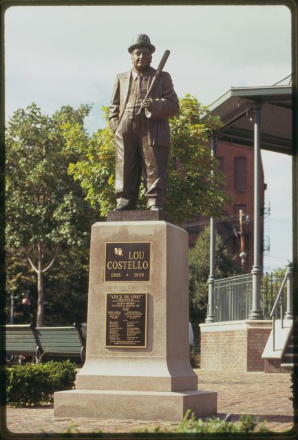 """Statue of Paterson native Lou Costello with banner that reads:  """"Lou Costello Memorial,"""" Cianci Street."""
