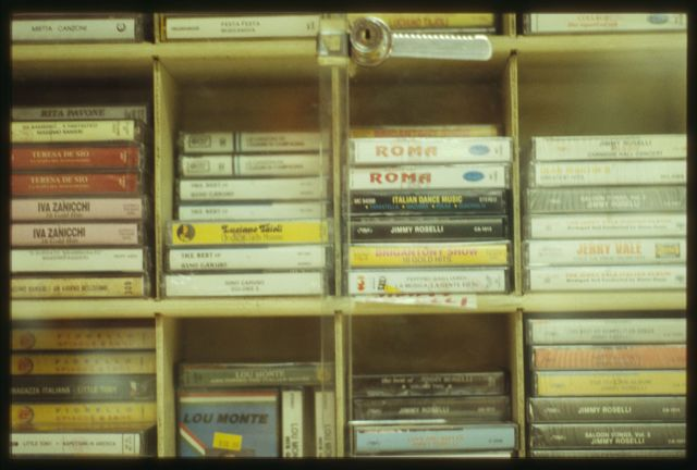 The case holding cassette tapes of recorded Italian music.