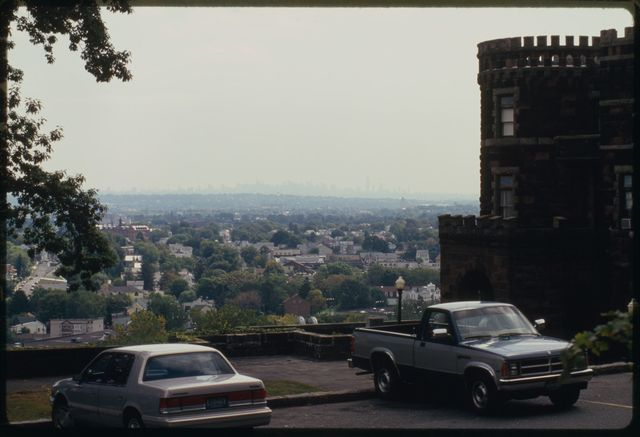 View looking east with Paterson in the foreground and New York City on the horizon.