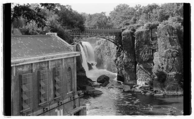 View of Great Falls; hydro-electric building in left foreground.