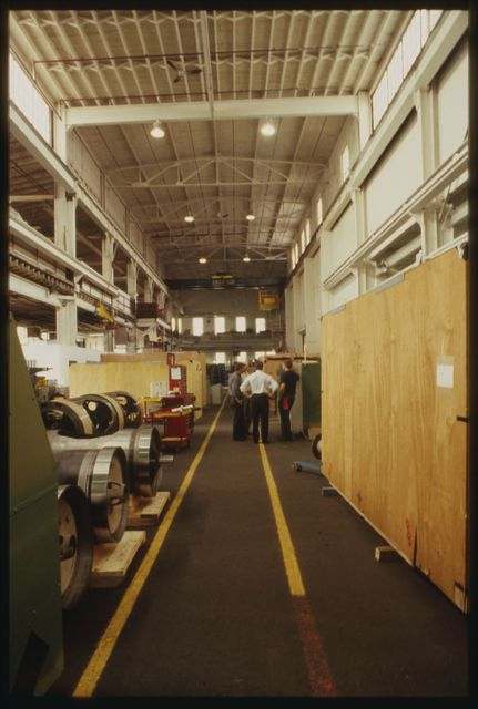 View of machine shop floor looking north with catwalk above on the left.