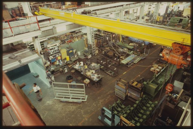 View of machine shop from catwalk above; in this view you are looking north with the crane in foreground, the assembly area to the lower left.