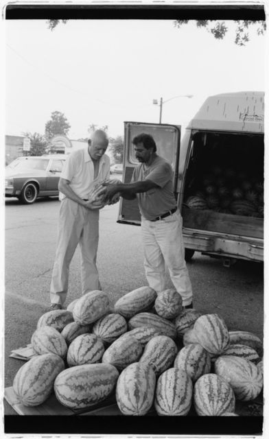 Watermelon seller (right) and customer.