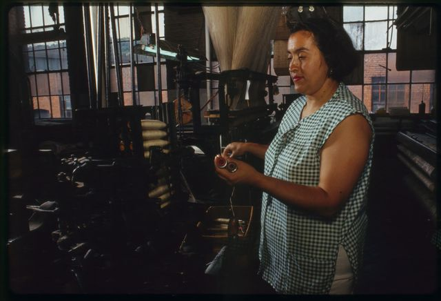 Weaver Maria Atiles at her loom on the second floor.