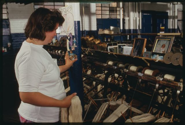 Winder Cindy Fanslau at work on the first floor; family photographs of Cindy's children are visible.