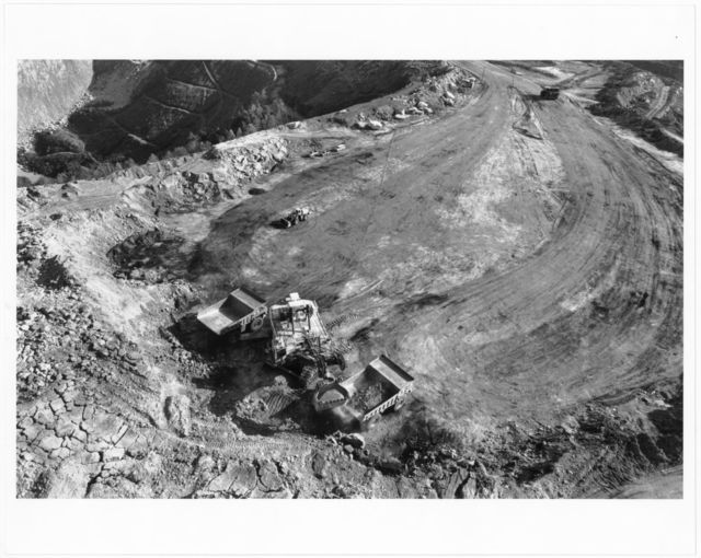 """""""Big John,"""" the dragline, loading rocks and dirt into two rock trucks at the Samples mountaintop removal site (close up)"""