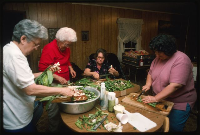 Cleaning ramps at the ramp house on the night before the ramp supper:  (L-R) Mabel Brown, Jenny Bonds, Peggy Gilfillen, Delores Workman