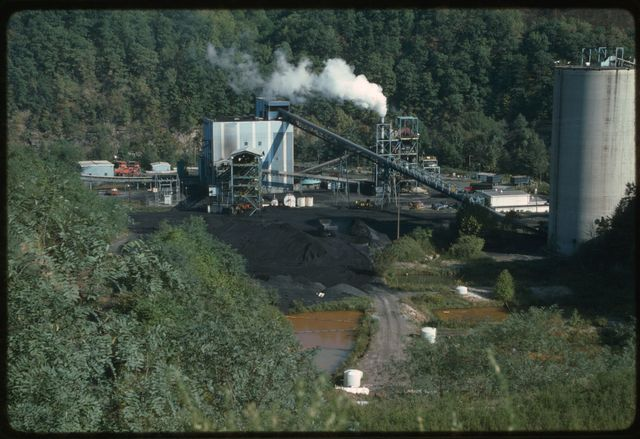 Coal cleaning plant as viewed from the sludge dam.  The pond is filled with waste from the coal cleaning process.
