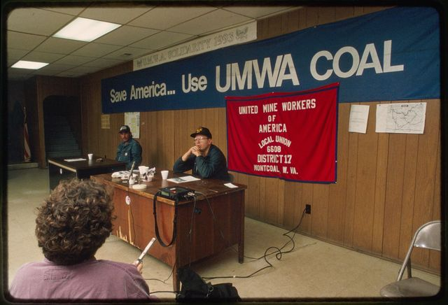 Mary Hufford, foreground, interviewing James Dye (left) and Jess Duncan, United Mine Workers of America union organizers, at the local union hall