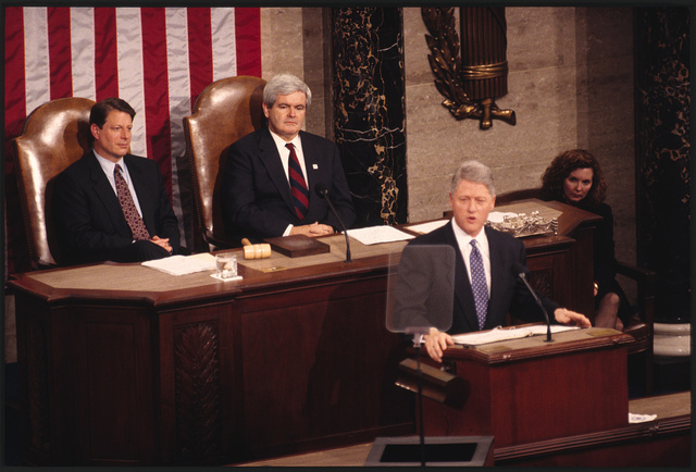 [President Bill Clinton delivering the State of the Union Address with Vice President Al Gore and Minority Whip Newt Gingrich sitting behind him]